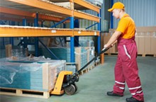 Employee Safely Handling Materials in Industry Workplace