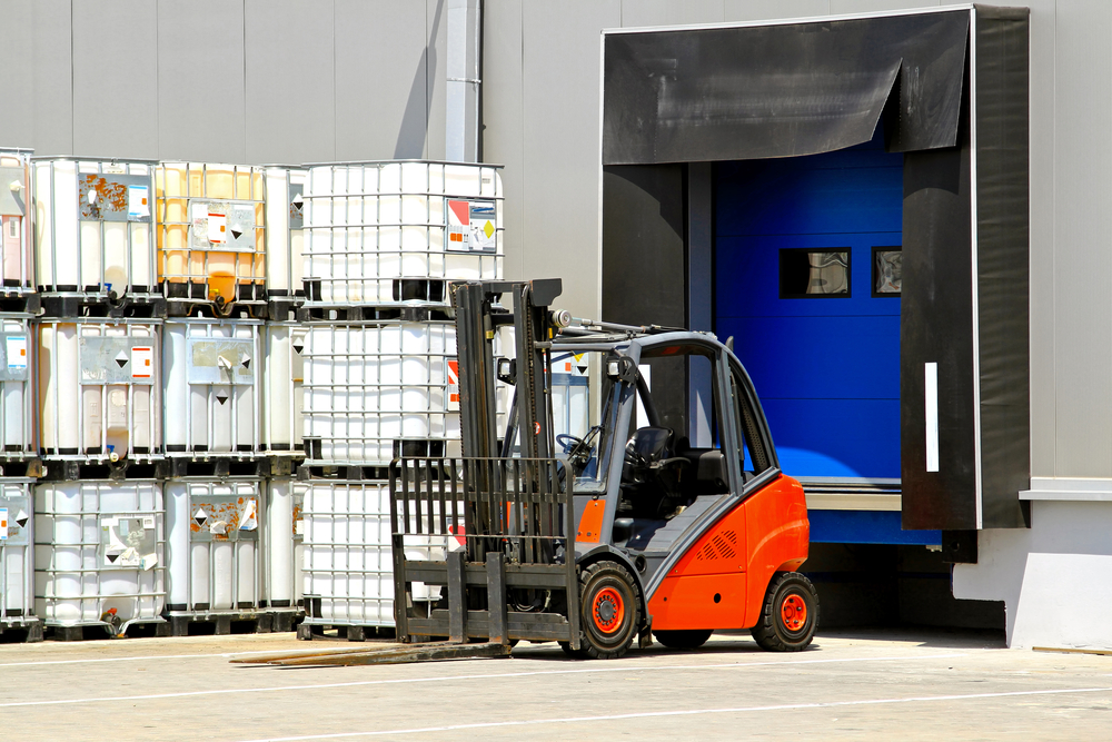 Outside_Storage_IBCs_Corrosive_With_Forklift.jpg