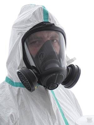 Person_Wearing_Respirator_Goggles_ProtectiveSuit_4.jpg